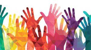 Multicolored hands raised